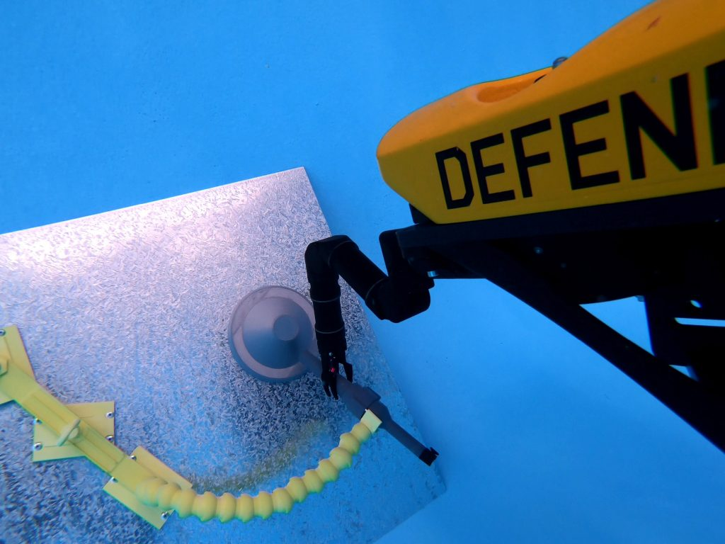 A VideoRay MSS Defender equipped with Blueprint Lab Reach 5 Mini underwater robotic arm carries out intervention trials