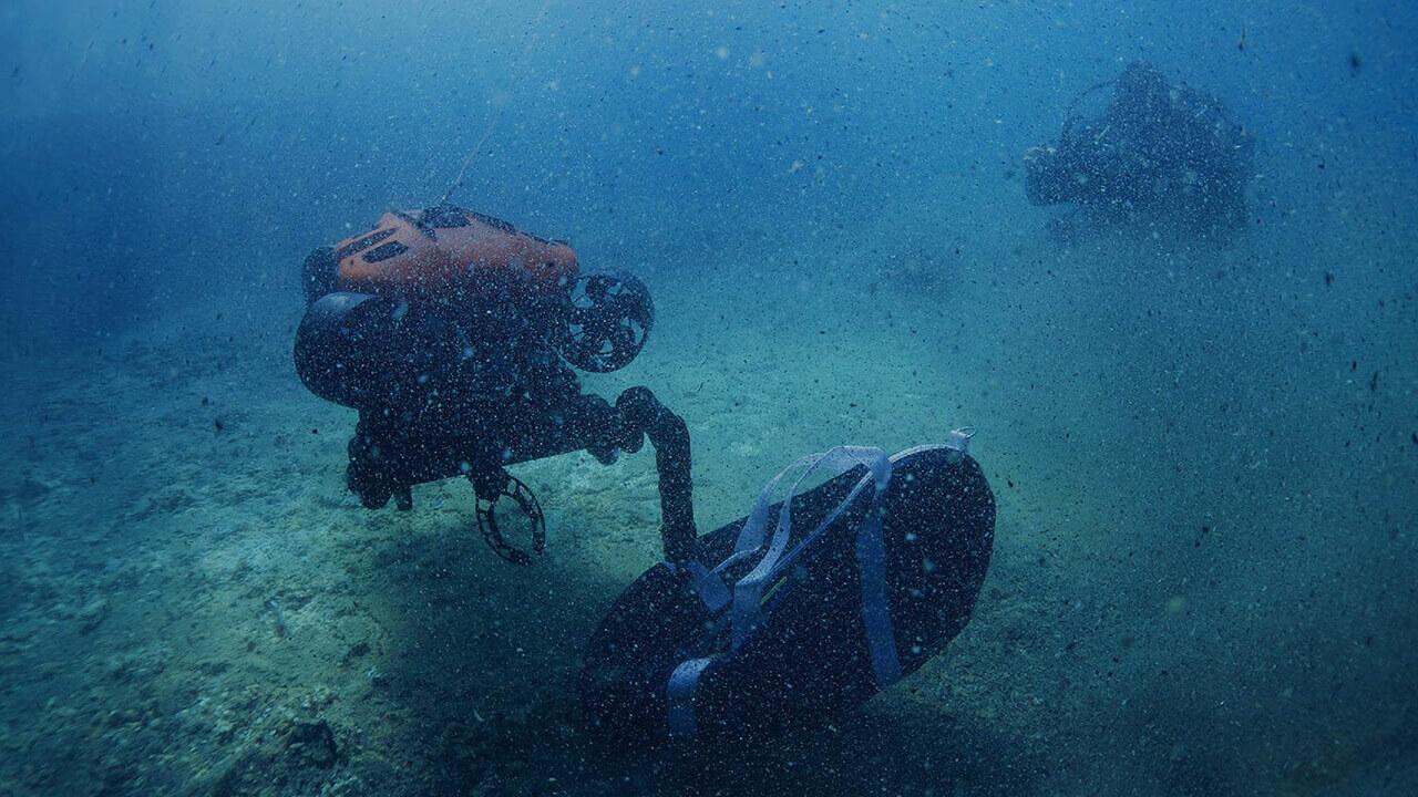 Robotic manipulator undertaking underwater research and marine biology, watch the video.
