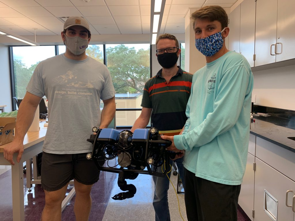 Members of the RkinD group at LSU with their Reach Alpha manipulator mounted on a Blue Robotics vehicle